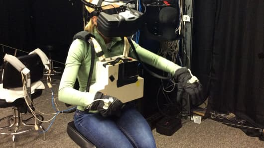 CNBC's Mary Thompson training for a virtual spacewalk.