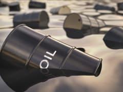 Oil barrels sinking in oil