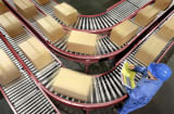 Moving cartons on conveyor belts.