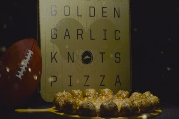 Get a gold-covered pizza from Pizza Hut