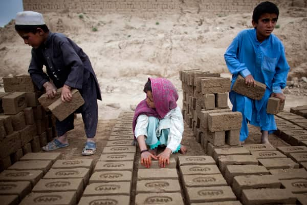 Afghan children in Kabul sort bricks at the Sadat brick factory, where they work from 8 a.m. to 5 p.m. daily.