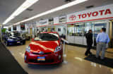 Toyota cars are on display in the showroom of Hollywood Toyota dealership in Los Angeles, California.