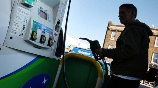 A customer fills up his car at a BP gas station in New York City.
