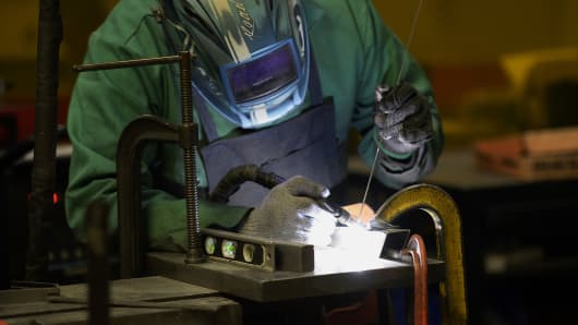 A worker TIG welds aluminum on the production line at the Littman Brands Troy-CSL Lighting Inc. manufacturing facility in Los Angeles.