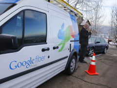 A technician gets cabling out of his truck to install Google Fiber