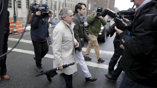 Former drug executive Martin Shkreli (center R) exits with his lawyer Benjamin Brafman outside the U.S. Federal Courthouse in Brooklyn, New York February 3, 2016.