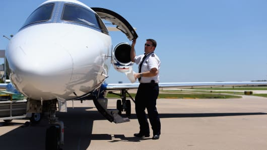 FlexJet First Officer Rob Caster conducts a post-flight inspection of a Learjet 45 aircraft after landing