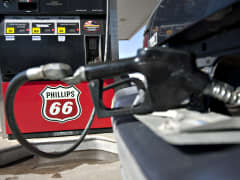 A Phillips 66 logo is seen on a gas pump as a car is filled a Beck's station in Princeton, Illinois.