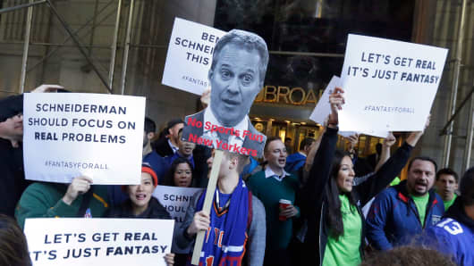 In this Nov. 13, 2015, file photo, fantasy sports fans demonstrate outside the Financial District offices of New York state Attorney General Eric Schneiderman, in New York.