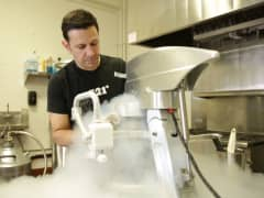 Scot Rubin mixes a batch of liquid nitrogen ice cream.