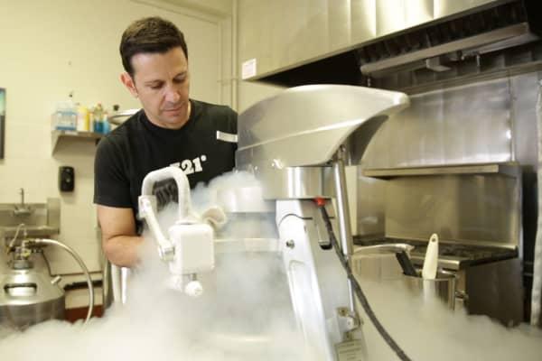 Scot Rubin mixes a batch of liquid nitrogen ice cream.