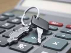 Calculator and car keys close-up