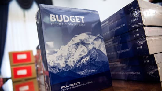 Congressional aids unpack boxes of the President's Fiscal Year 2017 Budget in the Cannon House Office Building on February 9, 2016 in Washington.