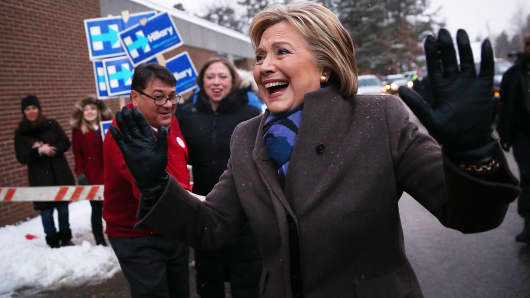Democratic presidential candidate former Secretary of State Hillary Clinton greets voters outside of a polling station at Parker Varney School on February 9, 2016 in Manchester, New Hampshire.