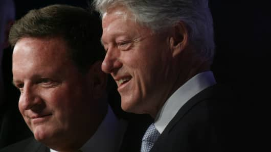 Ron Burkle, managing partner and founder of Yucaipa Cos., left, and former President Bill Clinton.