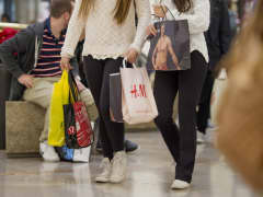 Shoppers carry bags while walking inside the Westfield San Francisco Centre in San Francisco.