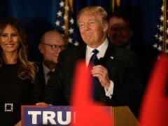 Republican presidential candidate Donald Trump speaks after Primary day at his election night watch party at the Executive Court Banquet facility on February 9, 2016 in Manchester, New Hampshire.