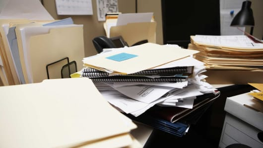 Piled work at a vacant desk