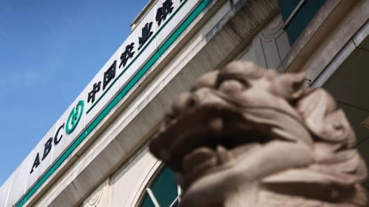 A lion statue stands outside an Agricultural Bank of China in Haikou, south China's Hainan province