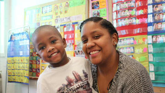 Nettia Caldwell, pictured with her son Jonathan, said that she would be forced to stop working and studying if universal pre-K didn't exist.