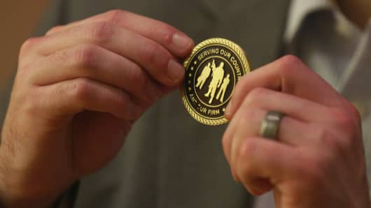 A pin given to veterans who now work for PwC.
