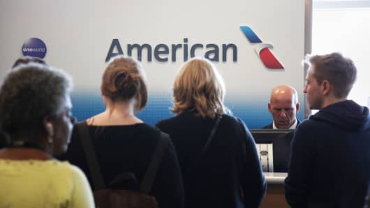 Passengers at an American Airlines gate at the Dallas/Fort Worth International airport in Dallas.
