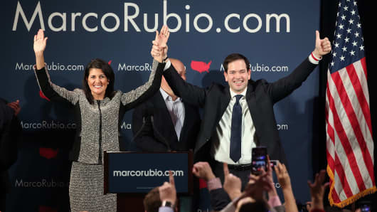 Republican presidential candidate Marco Rubio, right and South Carolina Gov. Nikki Haley, left, celebrate after Rubio addressed supporters at a primary night event in Columbia, S.C.