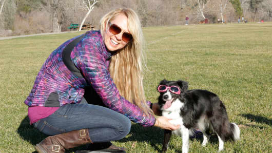 Doggles founder Roni Di Lullo with her mini Aussie, Ed.