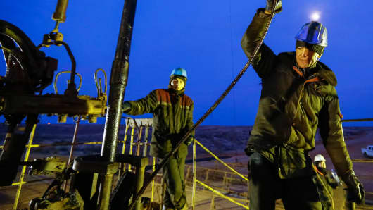 Workers at an oil well in Kazakhstan.