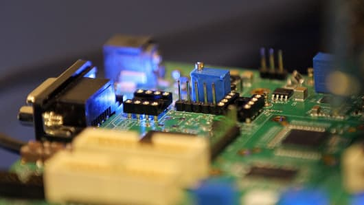 Semiconductors are seen on a circuit board.