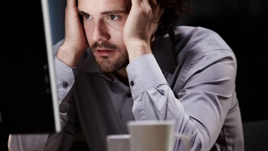 Stressed man in front of a computer