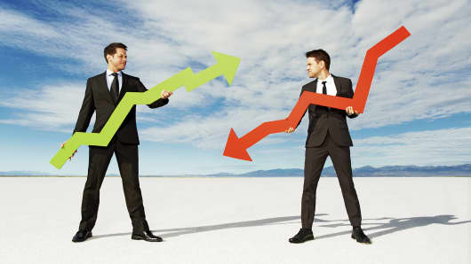 Businessmen with positive and negative arrows