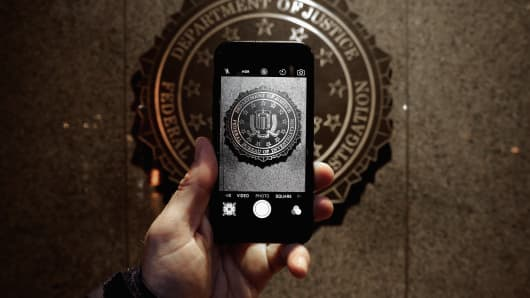 The official seal of the Federal Bureau of Investigation is seen on an iPhone's camera screen outside the J. Edgar Hoover headquarters on Feb. 23, 2016, in Washington, D.C.