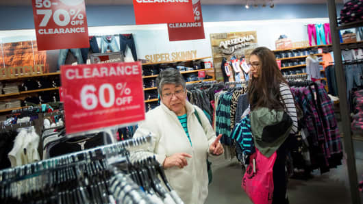 Shoppers browse clothing at a JC Penney store in Queens, New York.