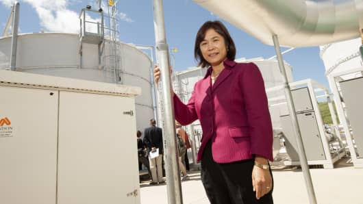 UC Davis researcher Ruihong Zhang has created technology that turns organic food waste, captured in the white tanks, into renewable energy generation.