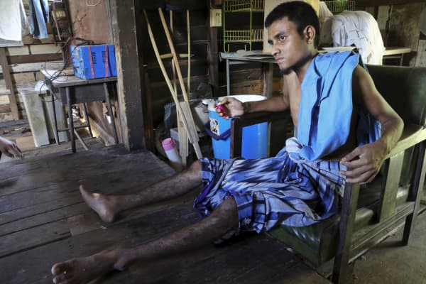 Rohingya migrant Muhammad Solim, 20, sits in a house in Nakhon Si Thammarat province, Thailand, April 28, 2015. Muhammad Solim, a Rohingya previously living as a refugee in Bangladesh, said he suffers from the effects of malnutrition after spending nearly three months at sea and 90 days in a jungle camp before he was ransomed for the equivalent of US$2,240, paid in baht and ringgit.