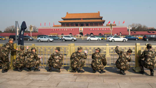 Armed police officers clean handrails at Tiananmen Square ahead of The Fourth Session of the 12th National People's Congress.