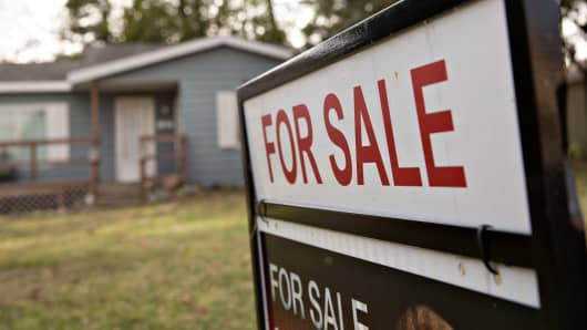 A 'For Sale' sign stands outside a home in Peoria, Illinois.