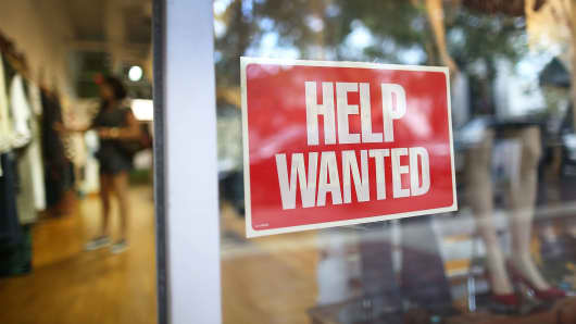A help wanted sign in the window of the Unika store in Miami, Florida.