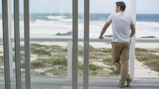 Wealth man overlooking ocean