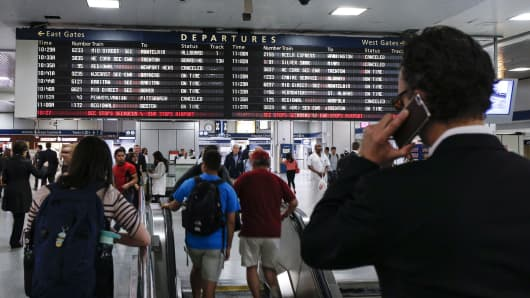 People arrive at Pennsylvania Station from a NJ Transit train in New York City.
