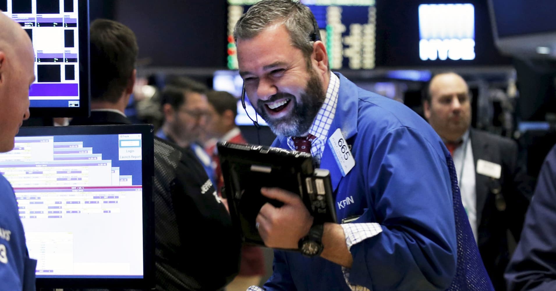 Dow rises 200 points as French election results spark rally; Nasdaq hits all-time high