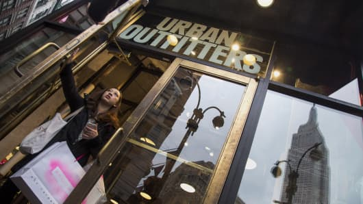 A shopper exits an Urban Outfitters Inc. store in New York, U.S.