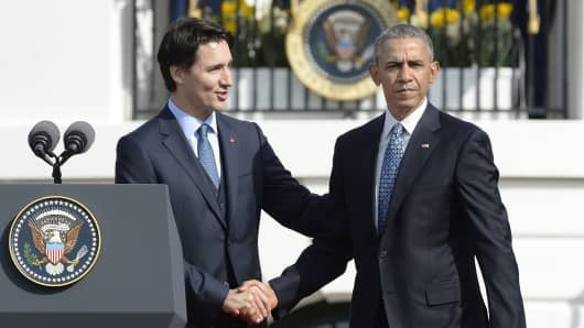 Canadian Prime Minister Justin Trudeau checks hands with President Barack Obama during a welcoming ceremony to the White House for an Official Visit March 10, 2016 in Washington, DC.