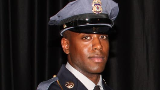 Jacai Colson, 28, a four-year veteran of the Prince George County police force, pictured in this police handout, was killed when a gunman opened fire at their District 3 police station, in Landover, Maryland, March 13, 2016
