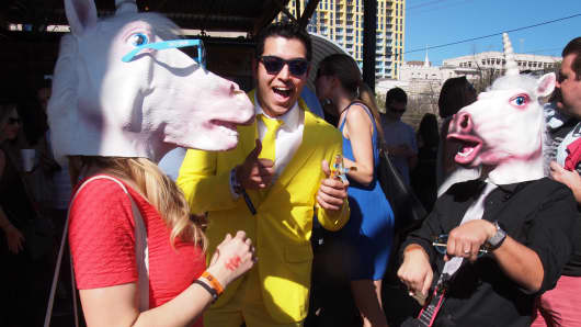 Partygoers with unicorn masks at the Hometown Hangover Cure party in Austin, Texas.
