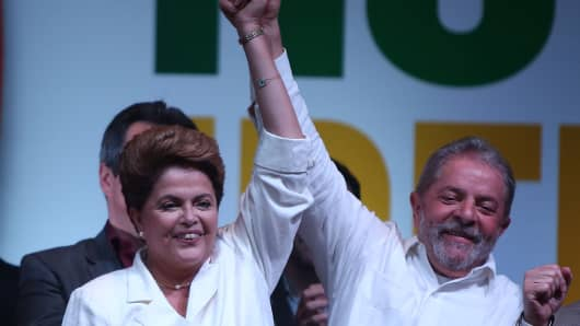 Brazilian President Dilma Rousseff celebrates with former president, Lula Da Silva, after being re-elected on October 26, 2014.