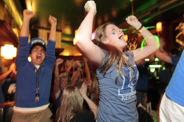 Kentucky fans celebrate watching the NCAA tournament in a bar in Lexington, KY. (File photo).