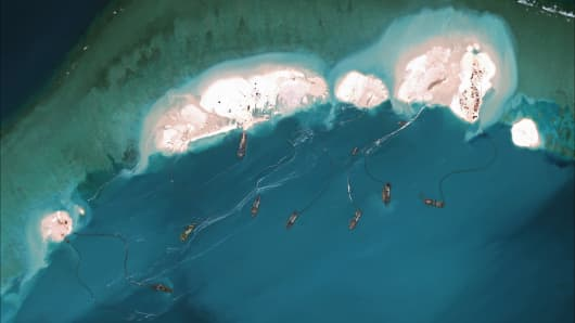 Construction and dredging underway at Mischief Reef, a large reef in the Spratly Islands in the South China Sea on March 16, 2015.