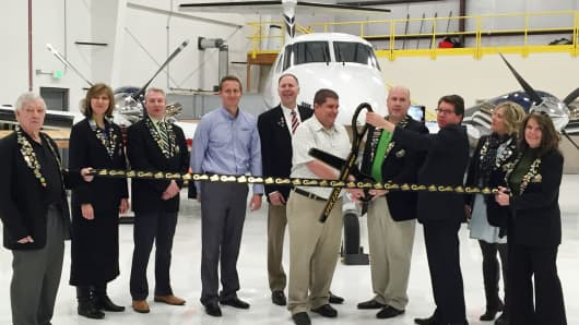 A ribbon-cutting ceremony at AMRG's new aircraft maintenance facility at Ogden-Hinckley Airport.